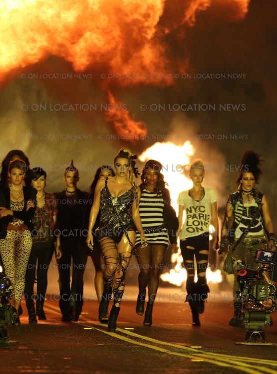 November 01st, 2010 Los Angeles, California. ***EXCLUSIVE*** Ke$ha films a music video for &quot;We R Who We R&quot;, a song she wrote in response to the recent gay youth suicides and bullying. Ke$ha was seen looking sexy and hard edged on the set of the Hype Williams directed music video. Ke$ha wore silver lipstick, sexy boots, a chain with locks, bullets, torn leggings and an outfit that looked like a broken mirror. She danced and performed all night long with &quot;her crew&quot; of diverse girls in a Downtown LA street tunnel which was rigged with fire and explosions to go off as the girls walked and danced through the Tunnel. There was also a car drag race scene filmed in the tunnel. Photo by Eric Ford/ On Location News. <br /> Telephone 818-613-3955 info@onlocationnews.com