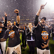 San Francisco Giants Hector Sanchez, left, Angel Pagan, center, and relief pitcher Sergio Romo celebrate winning the NLCS between the Giants and the St. Louis Cardinals on Monday October 22, 2012 at AT&T Park in San Francisco, California.