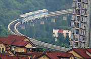 """CHONGQING, CHINA - JUNE 24: (CHINA OUT)<br /> <br /> """"90 Degree"""" Light Rail Line In Chongqing<br /> <br />  Line 2 of the Chongqing Light Rail Transit runs at a over 90 degree light rail line on June 24, 2014 in Chongqing, China. A group of pictures about a light rail running at a 90 degree light rail line became popular online these days, which made internet users worried about the safty of the light rail. Chen Xiaoji, a construction manager, said that Line 2 of the Chongqing Light Rail Transit has ran at the """"90 degree"""" light rail line for a decade, and it is totally safe due to the reason that the minimum railway curve radius of the """"90 degree"""" light rail line is 198 meters which is high above the safety line of 100 meters.<br /> ©Exclusivepix"""