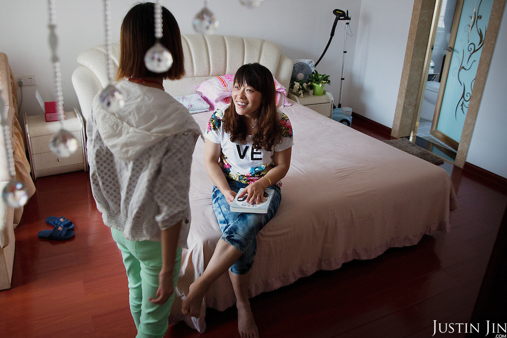A farmer until one year ago, Ms Li converses with a relative in southern China in her newly furnished apartment given by the government in return for seized land.<br /> <br /> China is pushing ahead with a dramatic, history-making plan to move 100 million rural residents into towns and cities over six years &mdash; but without a clear idea of how to pay for the gargantuan undertaking or whether the farmers involved want to move.<br />