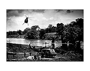 Helicopters land at a Nicaraguan Contra basecamp on the Honduras - Nicaragua border. 1987