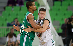 Lynn Greer of Unics Kazan vs Jan Mocnik of Union Olimpija during basketball match between KK Union Olimpija and Unics Kazan (RUS) of 10th Round in Group D of Regular season of Euroleague 2011/2012 on December 21, 2011, in Arena Stozice, Ljubljana, Slovenia. Unics Kazan defeated Union Olimpija 76-63. (Photo by Vid Ponikvar / Sportida)