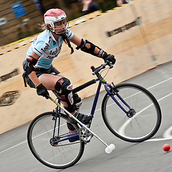 London, UK - 24 August 2012: one of the players during the Hell's Belles Vol 2, Ladies Bike Polo Tournament in Bethnal Green Gardens.