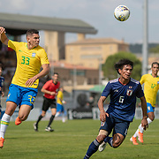 TOULON, FRANCE June 15.  Paulinho #33 of Brazil heads clear from Yaichi Naganuma #6 of Japan during the Brazil U22 V Japan U22 Final match at the Tournoi Maurice Revello at Stade D'Honneur on June 15th 2019 in Toulon, Provence, France. (Photo by Tim Clayton/Corbis via Getty Images)