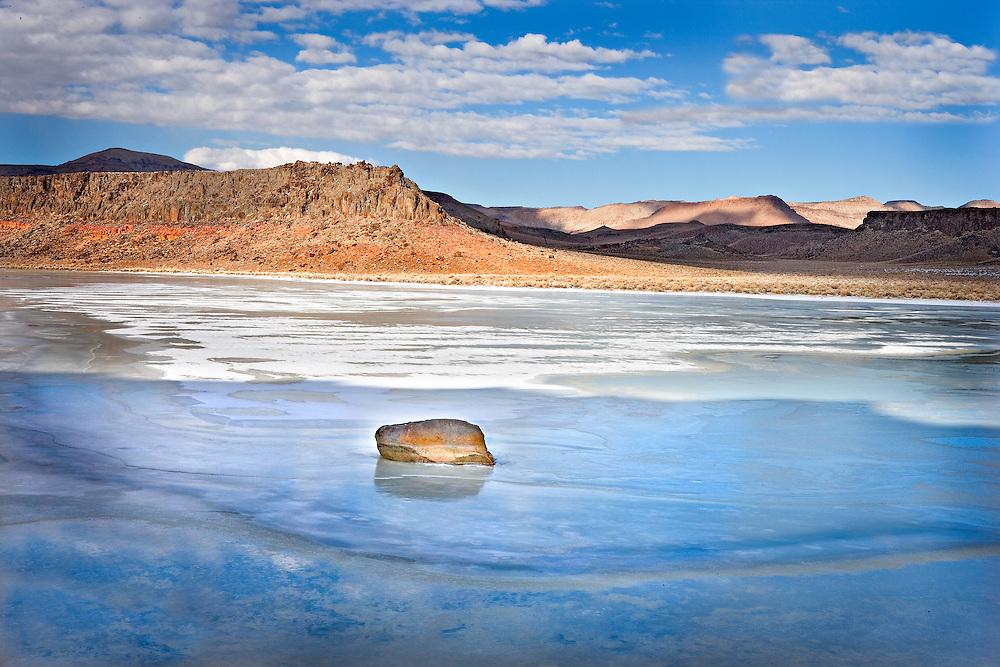 Rock in frozen Pond, Nevada