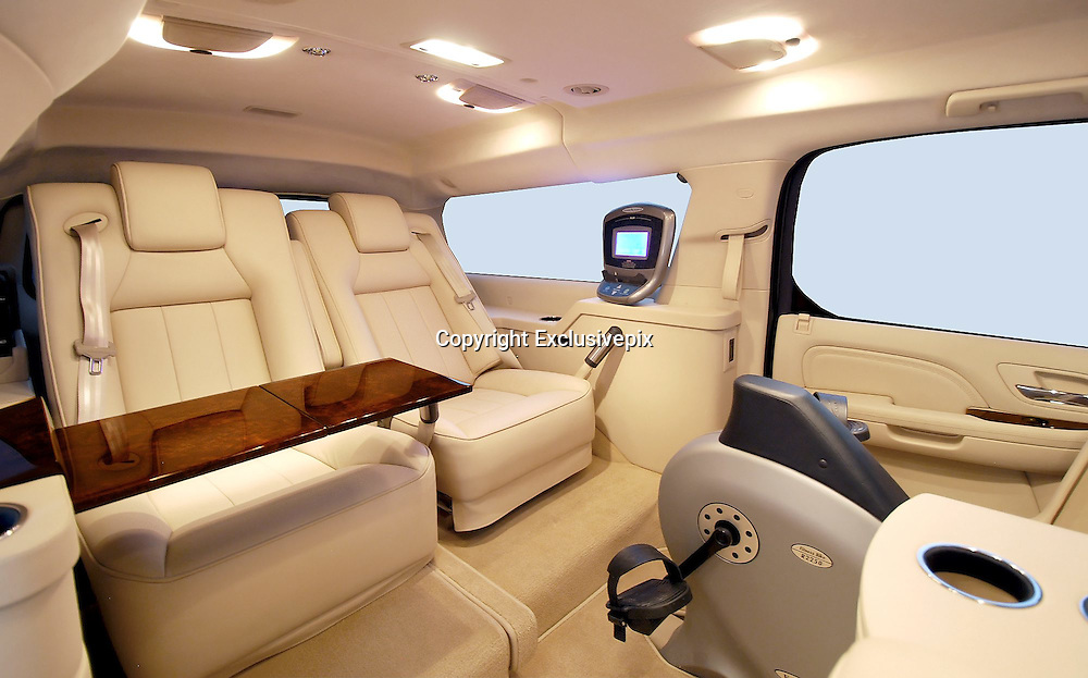 """How's that for a way to travel: Luxury limousine comes fitted out with drinks cabinet, computer system and even an exercise bike<br /> <br /> <br /> For most of us, taking a trip in the car means missing out on certain luxuries which we enjoy at home.<br /> However, for anyone wealthy enough to own this luxury limousine, that needs not be the case.<br /> The opulent vehicle comes fitted out with a number of incredible features, including a built-in exercise bike which can be used whilst sitting back in one of the leather seats.<br /> <br /> The vehicle also comes with a burr wood trimmings drinks cabinet, large screen HD television, surround sound system, wifi and computer system.<br /> There is also the option of armour plating for those high profile oligarchs or even politicians around the world who believe they need the security.<br /> The Cadillac Escalade ESVconversions vehicle has been made by US custom company Becker Automotive Designs.<br /> <br /> The vehicle costs between £83,500 and £161,000 depending on the final specifications.<br /> In advertising the vehicle, the company says: 'Gaining the edge in today's competitive business environment means using every minute of your busy day to its best advantage. <br /> 'The Becker Cadillac Escalade ESV allows you to transform travel time into some of the most tranquil, focused and productive time in your schedule.<br /> <br /> 'Powerfully equipped-with all of the comforts and amenities of the office at your fingertips, for those who appreciate the value of time.<br /> 'Manage correspondence, access the internet and get news and market updates on a full sized display integrated into the cabins Crestron-controlled privacy partition. <br /> 'Make calls and hold conferences when others simply cant. Becker's full mobile office suite allows voice and video communication any time.<br /> 'Conduct meetings in your quiet, spacious """"boardroom"""" and even produce documents on demand.<br /> 'Take the rush out of rush hour. Spe"""