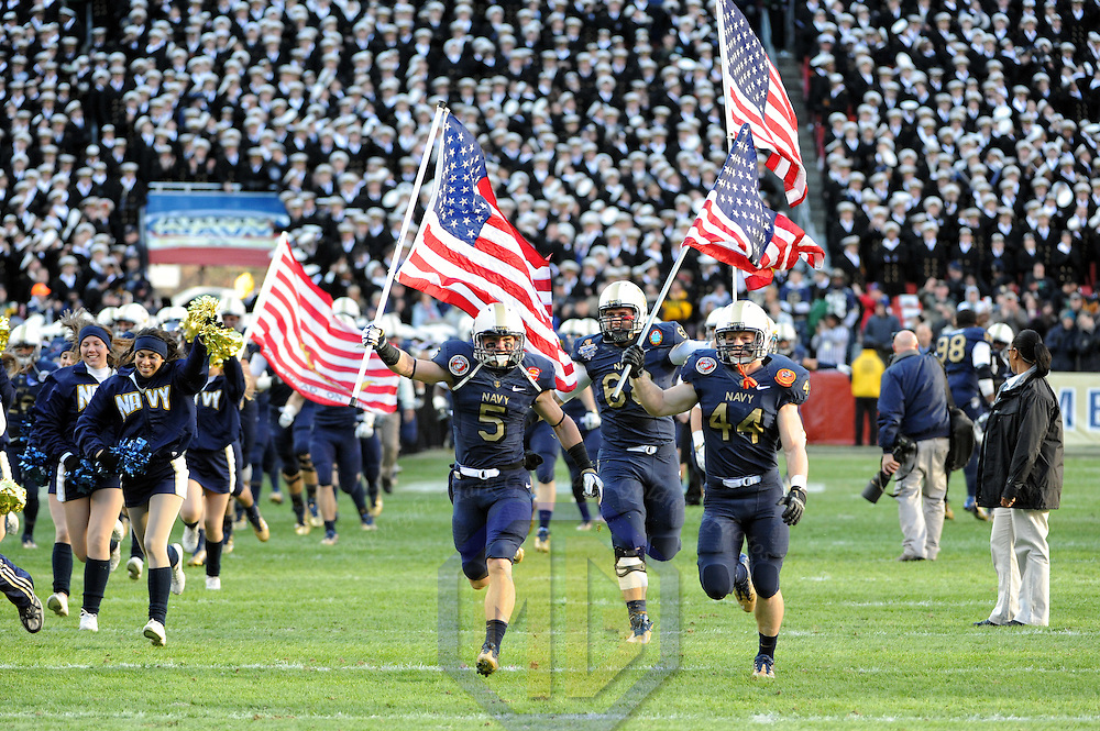 10 December 2011:  The Navy Midshipmen. led by Navy Midshipmen safety Brian Blick (5), linebacker Max Blue (44) and guard John Dowd (68) take the field for the game against the Army Black Knights at Fed Ex field in Landover, Md. in the 112th annual Army Navy game where Navy defeated Army, 27-21 for the 10th consecutive time.
