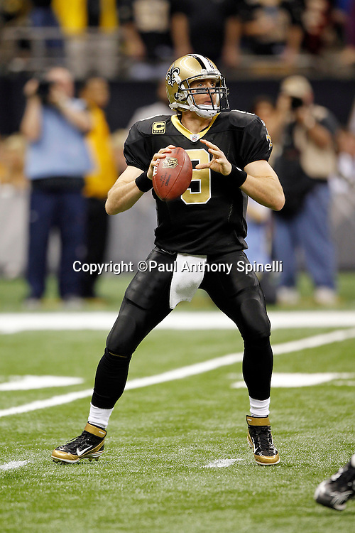 New Orleans Saints quarterback Drew Brees (9) throws a pass during the NFL wildcard playoff football game against the Detroit Lions on Saturday, January 7, 2012 in New Orleans, Louisiana. The Saints won the game 45-28. ©Paul Anthony Spinelli