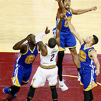 10 June 2016: Golden State Warriors forward James Michael McAdoo (20), Golden State Warriors guard Stephen Curry (30), Golden State Warriors forward Draymond Green (23) vie for the rebound with Cleveland Cavaliers guard Kyrie Irving (2) during the Golden State Warriors 108-97 victory over the Cleveland Cavaliers, during Game Four of the 2016 NBA Finals at the Quicken Loans Arena, Cleveland, Ohio, USA.