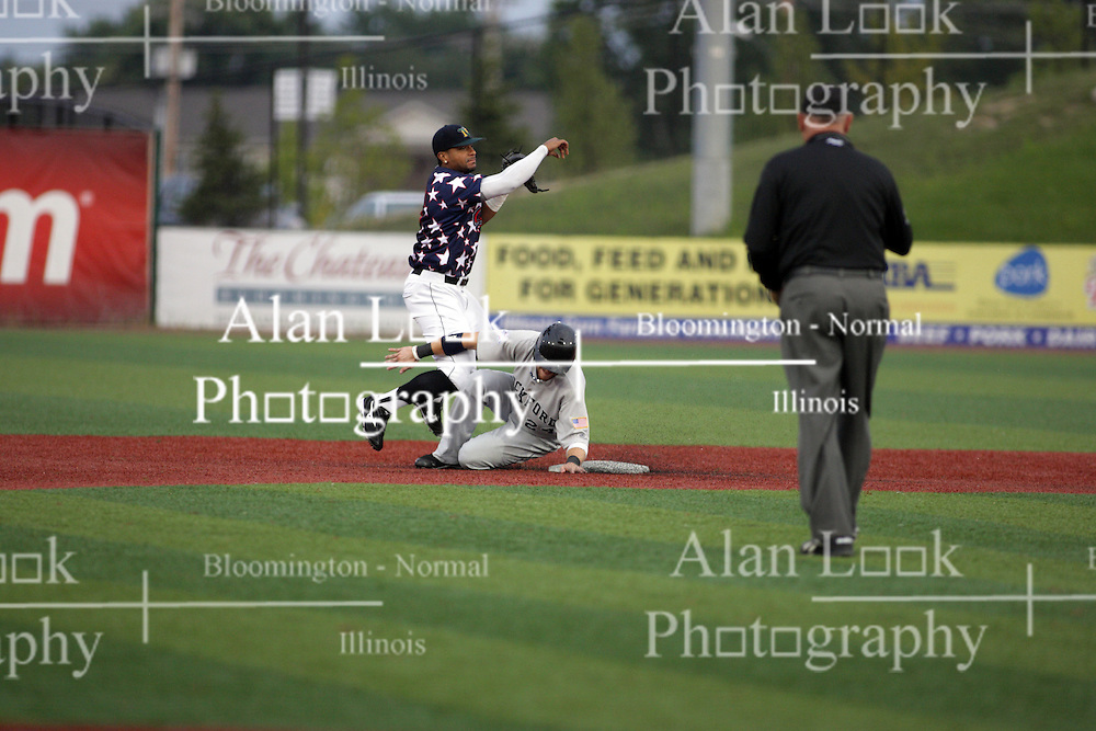 12 August 2011: Luis Parache slides in to second only to be forced out by a bag tag from Brandon Newton during a game between the Rockford River Hawks and the Normal Cornbelters at the Corn Crib in Normal Illinois.