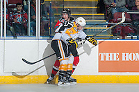 KELOWNA, CANADA - OCTOBER 25: Jesse Gabrielle #12 of Brandon Wheat Kings checks Jesse Lees #2 of Kelowna Rockets into the boards on October 25, 2014 at Prospera Place in Kelowna, British Columbia, Canada.  (Photo by Marissa Baecker/Shoot the Breeze)  *** Local Caption *** Jesse Gabrielle; Jesse Lees;