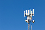 Antennas for 3 sector cellular  communications  mobile telephone system on a triangular lattice tower in Queensland, Australia. <br /> <br /> Editions:- Open Edition Print / Stock Image