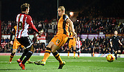 John Swift is too swift for the challenging Michael Dawson during the Sky Bet Championship match between Brentford and Hull City at Griffin Park, London, England on 3 November 2015. Photo by Michael Hulf.
