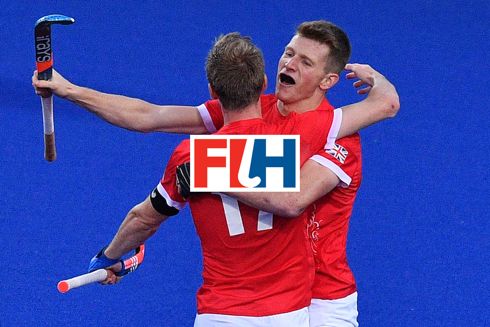 Great Britain's Sam Ward (R) and Britain's Barry Middleton celebrate after the mens's field hockey Britain vs Spain match of the Rio 2016 Olympics Games at the Olympic Hockey Centre in Rio de Janeiro on August, 12 2016. / AFP / Carl DE SOUZA        (Photo credit should read CARL DE SOUZA/AFP/Getty Images)