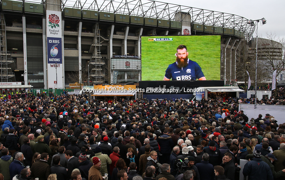 21 March 2015 - Six Nations Rugby - England v France ;  England fans watching the Ireland-Scotland match on the screen.<br /> Photo: Mark Leech
