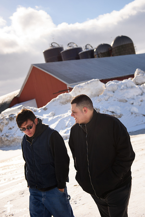 Vicar David Blas talks to manager Luis Romero at a dairy farm in rural Random Lake of Sheboygan County, Wis., on Thursday, Jan. 28, 2016. The missionary-at-large at LCMS Sheboygan County Hispanic Outreach and St. John's Lutheran Church of Plymouth, Wis., reaches out to Hispanic workers amongst the Hispanic population in the region. LCMS Communications/Erik M. Lunsford