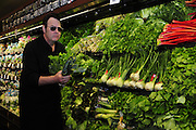 "1/28/13 New Orleans LA.-Actor Dan Aykroyd stops to check out the fresh ""greens"" at Rouses Supermarket before signing bottles of his Crystal Head Vodka. Aykroyd signs bottles of his Crystal  Head vodka at Rouse's Supermarket prior to Super Bowl XLV11 in New Orleans. Photo©Suzi Altman"