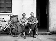 Shanghai Portraits 8 - Elderly friends sit toghther in a old neighborhood.