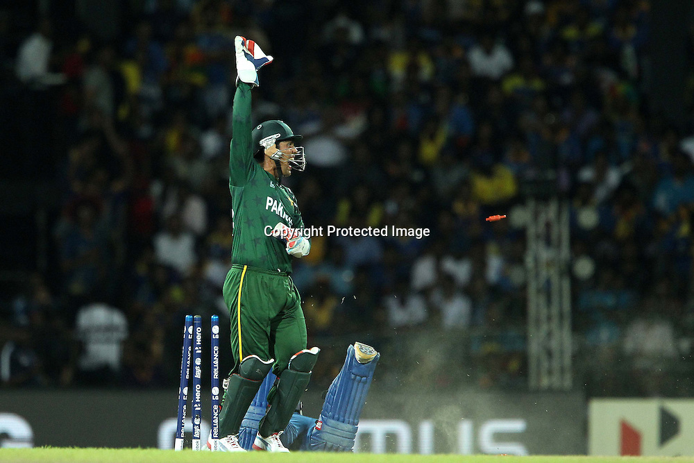 Kamran Akmal appeals for the run out during the ICC World Twenty20 semi final match between Sri Lanka and Pakistan held at the Premadasa Stadium in Colombo, Sri Lanka on the 4th October 2012<br /> <br /> Photo by Ron Gaunt/SPORTZPICS
