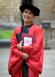 © Licensed to London News Pictures. 20/06/2012. Oxford, UK Aung San Suu Kyi leaves Oxford University today 20 June 2012 after receiving an Honary Degree at the Encaenia Ceremony.  The Burmese democracy leader is to receive an honorary doctorate in civil law at annual ceremony honouring the brightest and best. Other honorees include: former MI5 Director General Baroness Manningham-Buller; author David John Moore Cornwell (aka John le Carre); Harvard University president Professor Drew Gilpin Faust; and Sony chief executive Sir Howard Stringer. Photo credit : Stephen Simpson/LNP