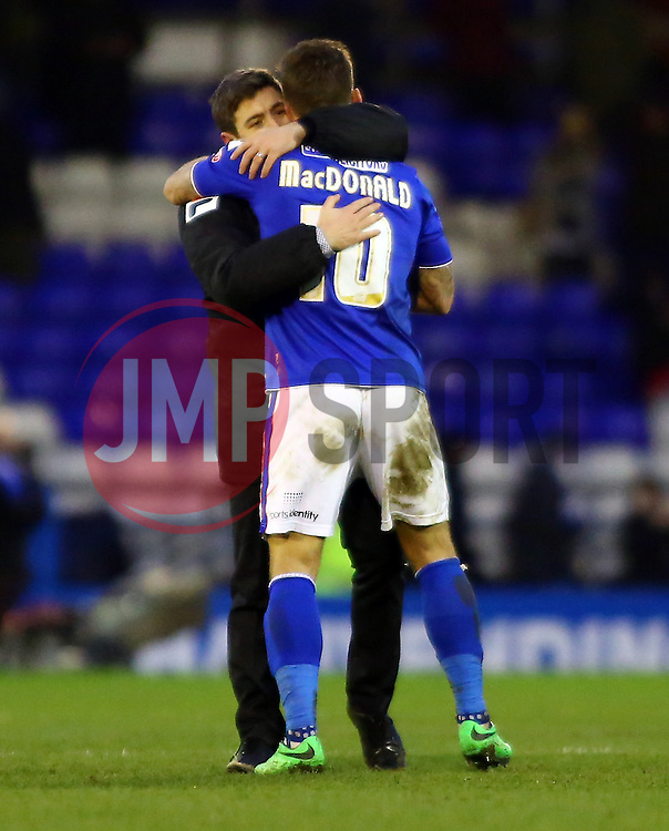 Oldham Athletic Manager, Lee Johnson congratulates Charlie MacDonald at full-time - Photo mandatory by-line: Joe Dent/JMP - Tel: Mobile: 07966 386802 25/01/2014 - SPORT - FOOTBALL - Boundary Park - Oldham - Oldham Athletic v Peterborough United - Sky Bet League One