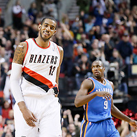 04 December 2013: Portland Trail Blazers power forward LaMarcus Aldridge (12) celebrates during the Portland Trail Blazers 111-104 victory over the Oklahoma City Thunder at the Moda Center, Portland, Oregon, USA.