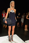 A blue halter-top dress with elaborate sandals. By Monika Chiang at Spring 2013 Fashion Week in New York.