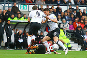 Derby County forward David Nugent (28) and Derby County midfielder Craig Bryson (4) collide during the EFL Sky Bet Championship match between Derby County and Brentford at the Pride Park, Derby, England on 22 September 2018.