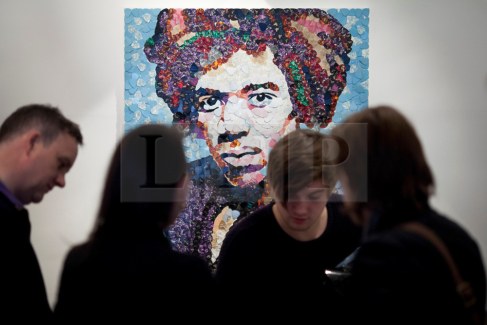 © Licensed to London News Pictures. 02/04/2013. London, UK. A portrait of Jimi Hendrix by Manchester based mosaic artist Ed Chapman from guitar plectrums is seen in a pop-up shop set up to celebrate a new album by the late guitar legend in London today (02/04/2013). The shop, called 'People, Hell and Angels' 'located near London's Carnaby Street, runs from the 1st of April until the 12th of April 2013 and features memorabilia, music and photographs of the guitarist and singer who died in 1970 of a drug overdose. Photo credit: Matt Cetti-Roberts/LNP