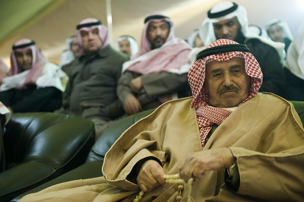 A tribal elder looks on as he listens to a speaker during a Jan 23 election rally near Kuwait City organized by candidate Anwar Al-Dahoum.  More than 400,000 Kuwaiti men and women are eligible to cast ballots to choose from among some 320 men and women candidates currently in the running in the February 2, 2012 parliamentary polls to elect a new 50-member National Assembly (parliament).