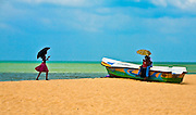 Local people enjoying the beach.<br /> (Photo by Matt Considine - Images of Asia Collection)