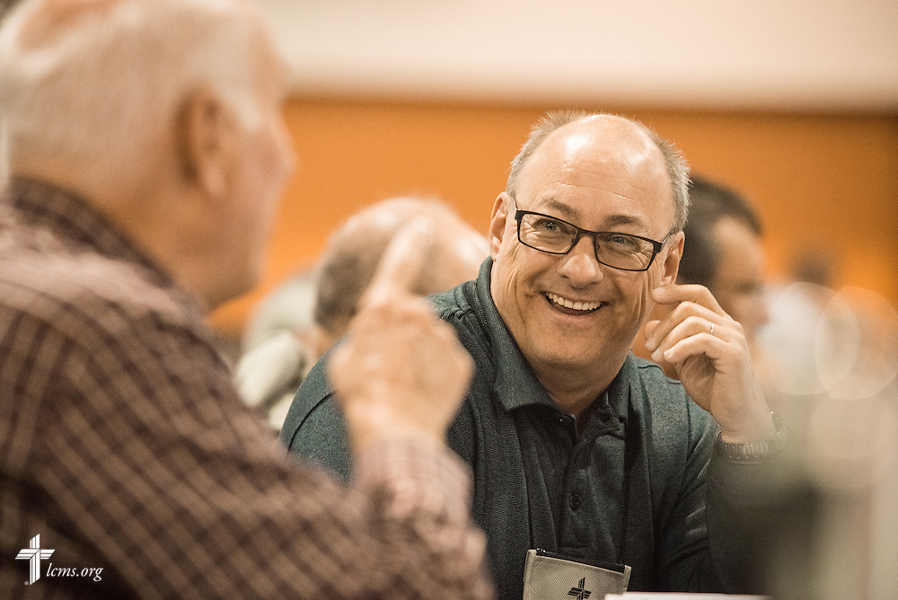 Delegates enjoy a lighthearted moment on Monday, July 11, 2016, at the 66th Regular Convention of The Lutheran Church–Missouri Synod, in Milwaukee. LCMS/Frank Kohn