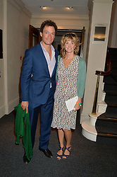 DOMINIC WEST and his wife CATHERINE at a reception to celebrate the publication of Hockney - A Pilgrim's Progress by Christopher Simon Sykes held at Sotheby's, New Bond Street, London on 30th September 2014.