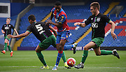 Aaron Bissaka looks to squeeze through the bristol defence during the Final Third Development League match between U21 Crystal Palace and U21 Bristol City at Selhurst Park, London, England on 3 November 2015. Photo by Michael Hulf.