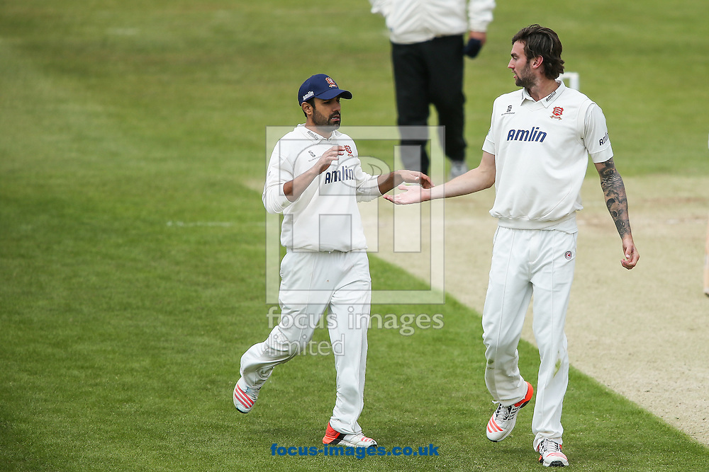 Ravi Bopara of Essex (left) congratulates Reece Topley of Essex (right) on taking the wicket of Rob Keogh of Northamptonshire (not shown)  during the LV County Championship Div Two match at the County Ground, Northampton<br /> Picture by Andy Kearns/Focus Images Ltd 0781 864 4264<br /> 08/06/2015