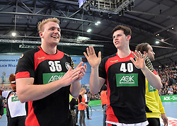 11.03.2016, Leipzig, GER, Handball Länderspiel, Deutschland vs Katar, Herren, im Bild Julius Kühn / Kuehn (GER #35) und Simon Ernst (GER #40) // during the men's Handball international Friendlies between Germany and Qatar in Leipzig, Germany on 2016/03/11. EXPA Pictures © 2016, PhotoCredit: EXPA/ Eibner-Pressefoto/ Modla<br /> <br /> *****ATTENTION - OUT of GER*****