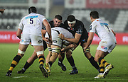 Gareth Thomas and Rory Thornton of the Ospreys tackle Jack Willis of Wasps during the Anglo Welsh Cup match between Ospreys and Wasps at The Liberty Stadium, Swansea, Wales on 10 November 2017. Photo by Andrew Lewis.