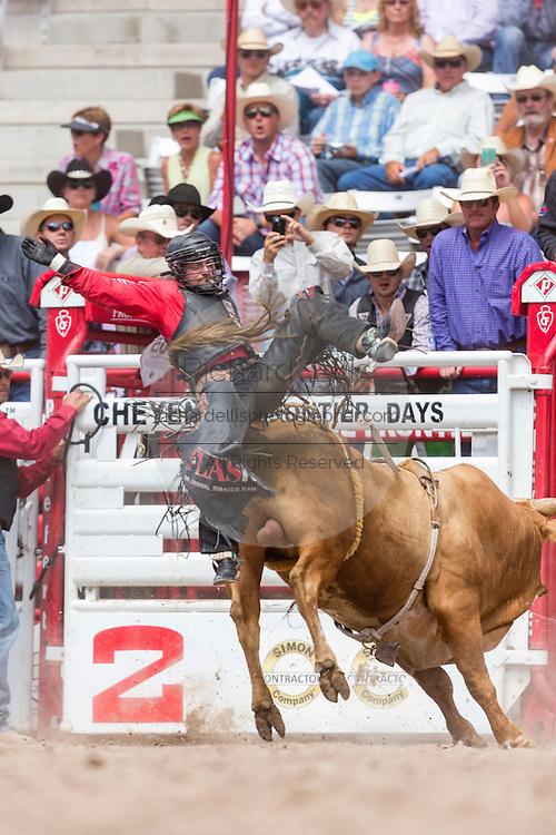 Bull rider Brennon Eldred is tossed from his bull during the Bull Riding finals at the Cheyenne Frontier Days rodeo in Frontier Park Arena July 26, 2015 in Cheyenne, Wyoming. Frontier Days celebrates the cowboy traditions of the west with a rodeo, parade and fair.