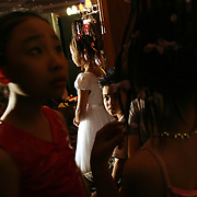 Pre-teen models wait backstage before hitting the catwalk at a fashion show in Hanoi, Vietnam. With government-instituted market reforms and a rapidly growing economy, young urban Vietnamese now have more disposable income to spend on mobile phones, slick motorbikes and up-to-date fashions.