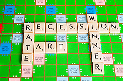 Scrabble Board spelling out words related to to recession.
