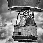 Four people clearly enjoying themselves in the basket.  I'm not sure how far they went or how high.  Someday maybe I'll be able to do that!<br />