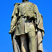 Charles Gordon-Lennox Statue in Huntly, Scotland <br /> Charles Gordon-Lennox (1791 – 1860) was the son of Charles Lennox, the 4th Duke of Richmond, and the nephew of George Gordon, the 5th Duke of Gordon. This resulted in Charles becoming the 5th Duke of Richmond and Lennox. He was an aide-de-camp (assistant) to Field Marshal Arthur Wellesley during the defeat of Napoléon Bonaparte at the Battle of Waterloo in 1815.  He was also the Postmaster General from 1830 until 1834. This bronze statue by sculptor Alexander Brodie was erected in The Square in 1862.