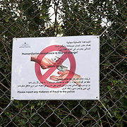 Greece with Doctors of the World (Medecins du monde). Lesvos. Moria camp for refugees in transit from Turkey to Greece. A notice telling refugees that humanitarian aid is free.