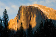 A sunset reflection of Half Dome in the Merced River in Yosemite National Park