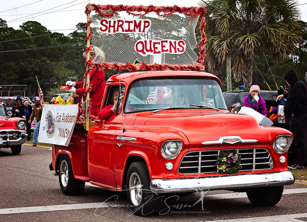 Members of the Organized Seafood Association of Alabama (Eat Alabama Wild Seafood) ride in a classic 3100 Chevrolet pickup truck as they participate in the Krewe de la Dauphine Mardi Gras Parade, Jan. 28, 2017, in Dauphin Island, Alabama. The organization promotes the understanding and marketing of the local seafood industry. (Photo by Carmen K. Sisson/Cloudybright)
