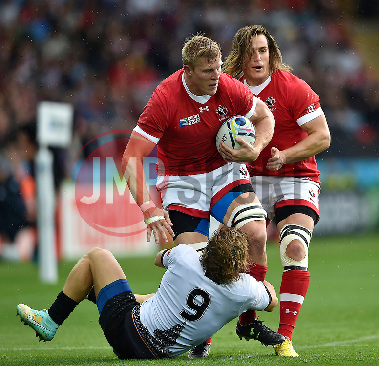 John Moonlight of Canada is tackled by Florin Surugiu of Romania - Mandatory byline: Patrick Khachfe/JMP - 07966 386802 - 06/10/2015 - RUGBY UNION - Leicester City Stadium - Leicester, England - Canada v Romania - Rugby World Cup 2015 Pool D.