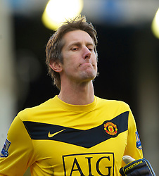 LIVERPOOL, ENGLAND - Saturday, February 20, 2010: Manchester United's goalkeeper Edwin van der Sar in action against Everton during the Premiership match at Goodison Park. (Photo by: David Rawcliffe/Propaganda)