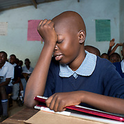 Kenya. Kisumu.Emelda Akinyi, 13 years old, blind, at Joel Omino School. In class.