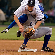 Columbus Clippers' second baseman Brent Abernathy crashes down on top of Shawn Riggans and completes the double play with first baseman Larry Broadway on Thursday April 19, 2007. The Clippers won 5-4.