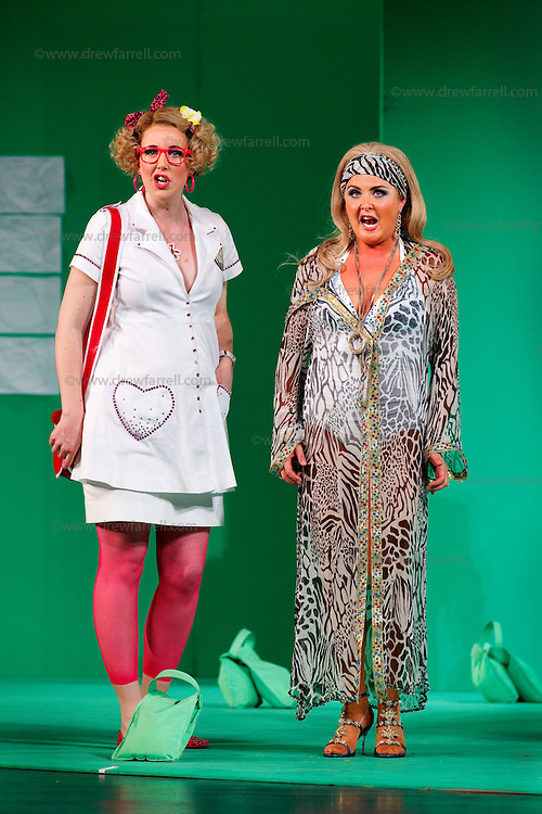 Picture shows : Julia Riley as Zulma and Mary O'Sullivan as Elvira (r)..Picture  ©  Drew Farrell Tel : 07721 -735041..A new Scottish Opera production of  Rossini's 'The Italian Girl in Algiers' opens at The Theatre Royal Glasgow on Wednesday 21st October 2009..(Soap) opera as you've never seen it before.Tonight on Algiers.....Colin McColl's cheeky take on Rossini's comic opera is a riot of bunny girls, beach balls, and small screen heroes with big screen egos. Set in a TV studio during the filming of popular Latino soap, Algiers, the show pits Rossini's typically playful and lyrical music against the shoreline shenanigans of cast and crew. You'd think the scandal would be confined to the outrageous storylines, but there's as much action off set as there is on.....Italian bass Tiziano Bracci makes his UK debut in the role of Mustafa. Scottish mezzo-soprano Karen Cargill, who the Guardian called a 'bright star' for her performance as Rosina in Scottish Opera's 2007 production of The Barber of Seville, sings Isabella..Cast .Mustafa...Tiziano Bracci.Isabella..Karen Cargill.Lindoro...Thomas Walker.Elvira...Mary O'Sullivan.Zulma...Julia Riley.Haly...Paul Carey Jones.Taddeo...Adrian Powter..Conductors.Wyn Davies.Derek Clarke (Nov 14)..Director by Colin McColl.Set and Lighting Designer by Tony Rabbit.Costume Designer by Nic Smillie..New co-production with New Zealand Opera.Production supported by.The Scottish Opera Syndicate.Sung in Italian with English supertitles..Performances.Theatre Royal, Glasgow - October 21, 25,29,31..Eden Court, Inverness - November 7. .His Majesty's Theatre, Aberdeen  - November 14..Festival Theatre,Edinburgh - November 21, 25, 27 ...Note to Editors:  This image is free to be used editorially in the promotion of Scottish Opera. Without prejudice ALL other licences without prior consent will be deemed a breach of copyright under the 1988. Copyright Design and Patents Act  and will be subject to payment or legal action, where appropriate..Further